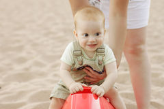 Baby boy has fun on beach Stock Photography