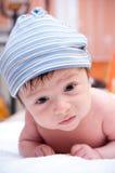 Baby boy in hat. Portrait of wet baby boy in hat lying on sift towel Stock Image