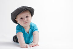 Baby boy with hat. On white background looking straight stock photography