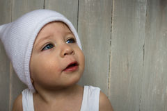 Baby boy in hat face expression stock image