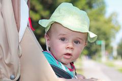 Baby boy with hat in stroller Royalty Free Stock Image