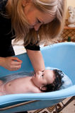 Baby boy having bath Stock Photos