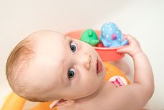 Baby boy having bath, looking Royalty Free Stock Photo