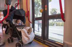 Baby boy having fun during a ride at streetcar, Spain Stock Photography