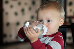 Baby boy having his bottle Royalty Free Stock Photography
