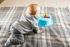 Baby boy having his nine month birthday. And big cake Royalty Free Stock Images