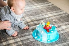 Baby boy having his nine month birthday. And big cake Royalty Free Stock Photography