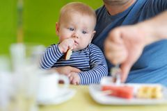 Baby boy having piece of bread Stock Image