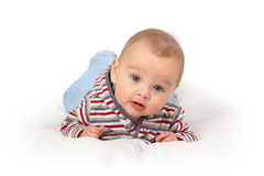 Baby boy having surprised expression. Liitle baby boy having a surprised expression Stock Image