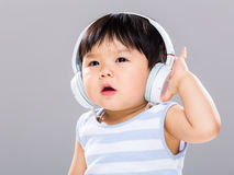 Baby boy with headphone Stock Photography