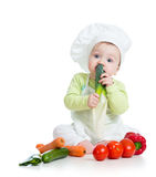 Baby boy with healthy food vegetables Royalty Free Stock Photo