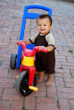 Baby boy with his bike Stock Photos