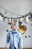 Baby  boy on his birthday party. Cute happy  baby  boy on his birthday party Royalty Free Stock Photography