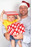 Baby boy with his father for Christmas Stock Image