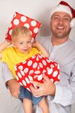 Baby boy with his father for Christmas Stock Photography