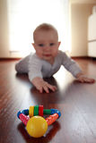 Baby boy with his first toys royalty free stock photography