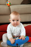 Baby boy with his first toys royalty free stock photo
