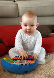 Baby boy with his first toys stock photo