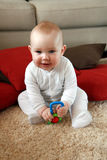 Baby boy with his first toys Royalty Free Stock Images