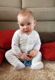 Baby boy with his first toys stock photography