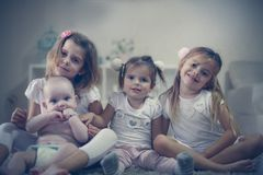 Baby boy with his little sisters. Portrait. royalty free stock photo