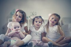 Baby boy with his little sisters. Portrait. stock photography