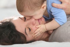Baby boy and his mother cuddling. Portrait of mother cuddling baby boy Stock Image