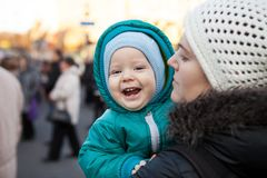 Baby boy and his mother outdoors in wintertime Stock Photo