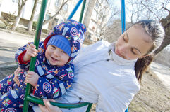Baby boy and his mother on swing Royalty Free Stock Images