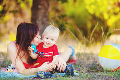 Baby boy with his mum in the park Royalty Free Stock Image