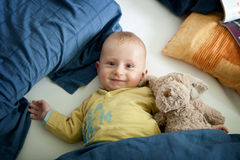 Baby boy with his teddy bear Stock Photo
