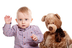Baby boy and his teddy bear Royalty Free Stock Photos