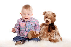 Baby boy and his teddy bear Royalty Free Stock Image