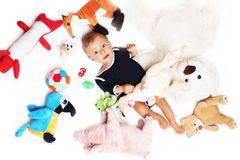 Baby boy and his toys stock images