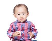 Baby boy hold wooden block Stock Photos