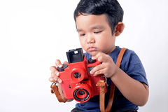 Baby boy holding camera Stock Photography