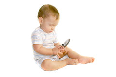 Baby boy holding a cell phone. Over white Royalty Free Stock Photo