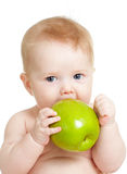 Baby boy holding and eating green apple. Isolated on white Stock Photo