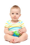 Baby boy holding milk bottle Royalty Free Stock Photography