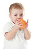 Baby boy holding an orange Royalty Free Stock Images