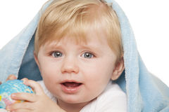 Baby boy holds small globe in his hands Royalty Free Stock Image