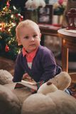 Baby boy at home near Christmas tree Stock Image