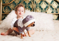 Baby boy at homeplaying with dog Stock Photography
