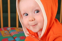Baby boy with hood royalty free stock photo