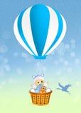 Baby boy on hot air balloon Stock Photo