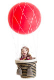 Baby boy on hot air balloon Stock Image