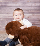 Baby boy with huge monkey toy Royalty Free Stock Photo