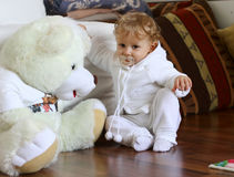 Baby boy with huge teddy bear royalty free stock photos