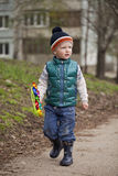 Baby Boy In Green Jaket And Blue Jeans Royalty Free Stock Photo