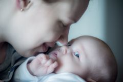 Baby boy infant with his mother Royalty Free Stock Photos